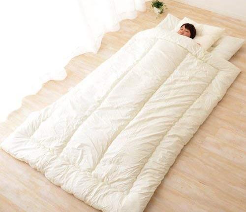 sleeping on the floor with a japanese futon mattress set