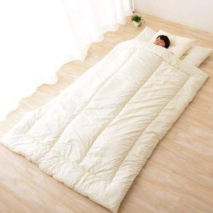 Japanese futon shikibuton sleeping on the ground for your back pain